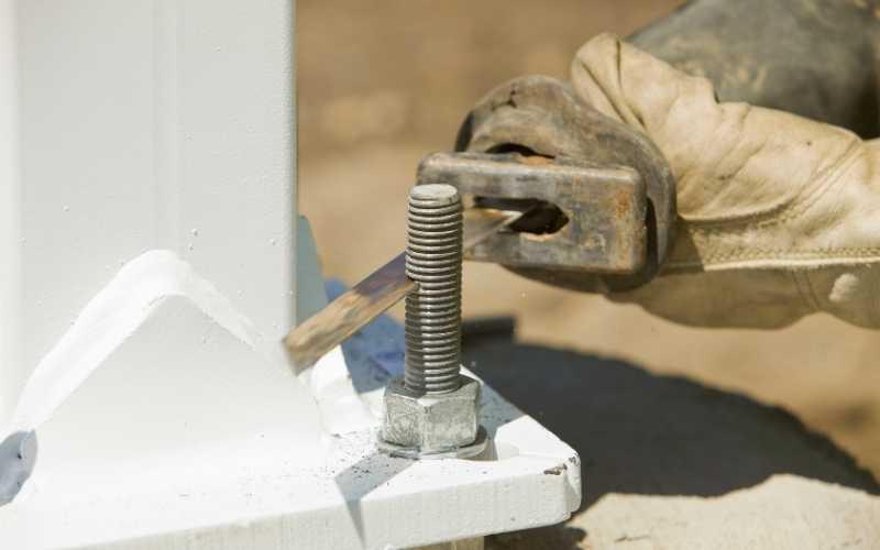 reciprocating saw cutting metal bolt