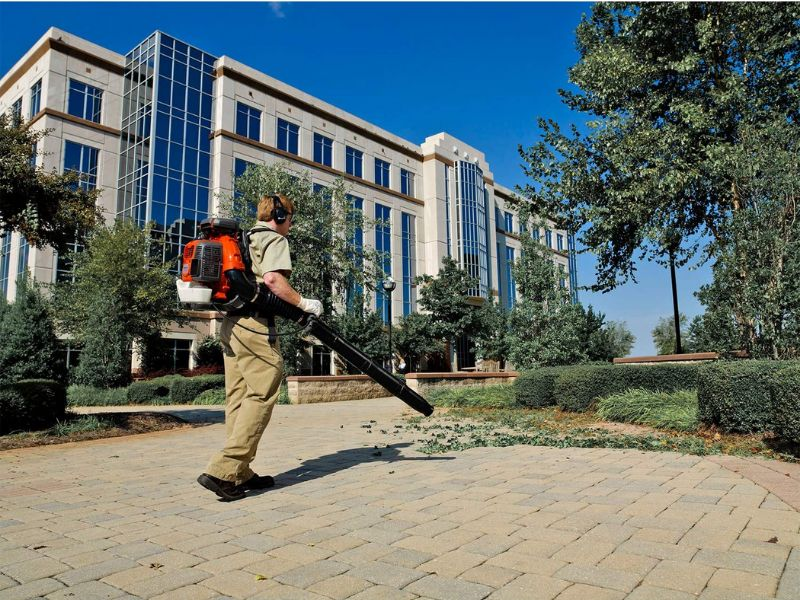 man using backpack leaf blower