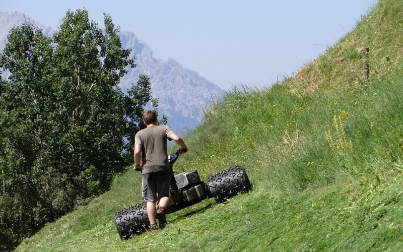 mowing a lawn on a slope