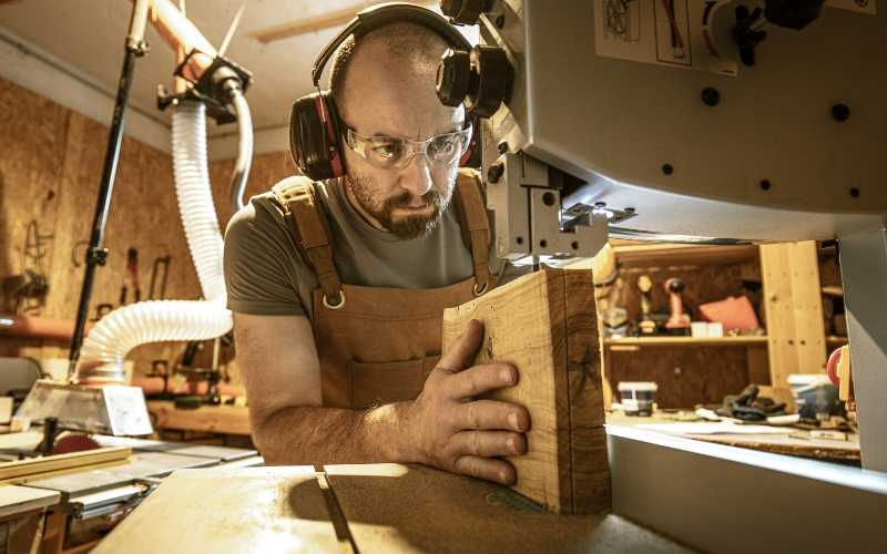 woodworker resawing wood on a bandsaw